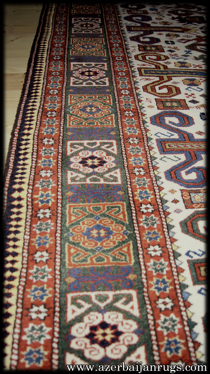 A Fine Perepedil Kuba Rug In An Ivory Ground