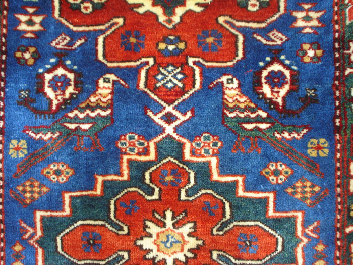A Karabagh Lampa Rug With Various Perching Birds Parrots