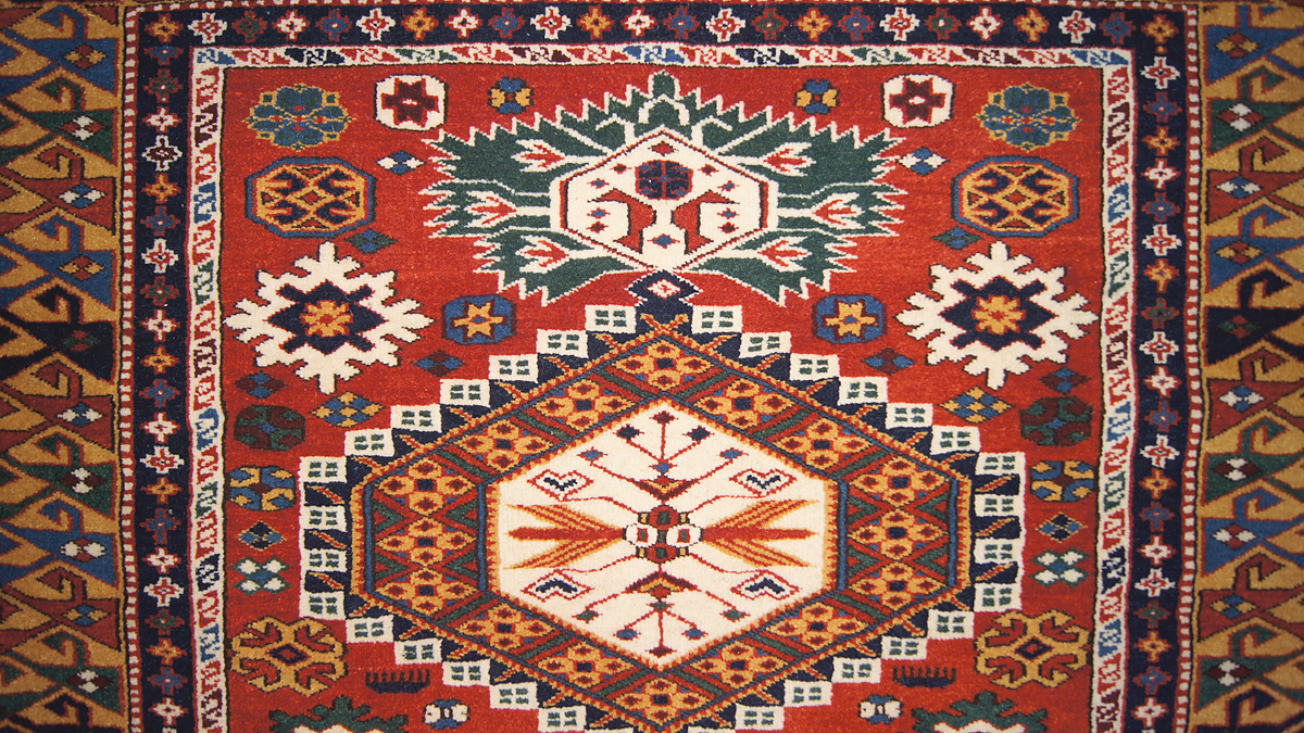 A Kuba Rug With Ancient Egyptian And Persian Royal