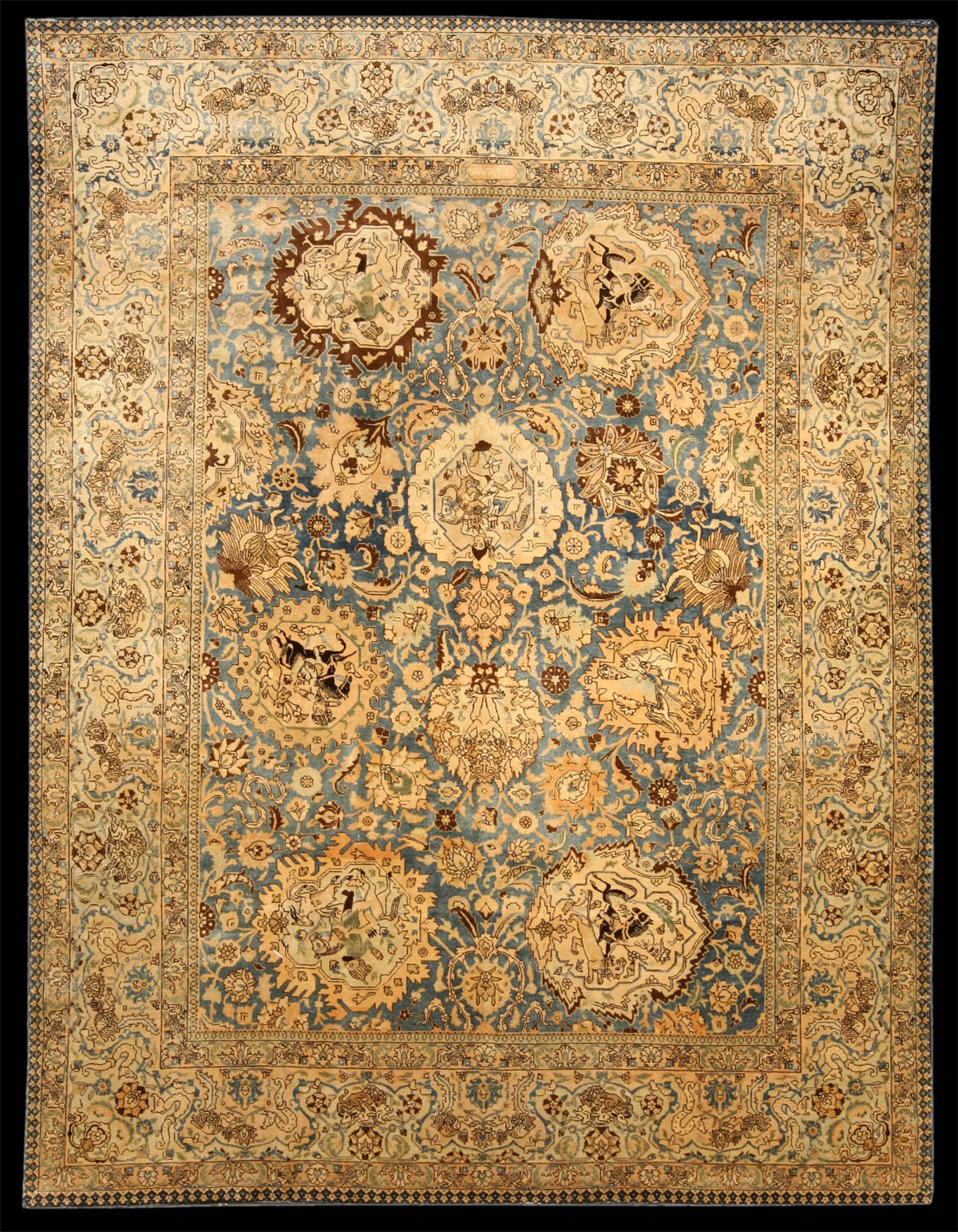 Tabriz antique rug, the abrashed blue field with a cloud ...